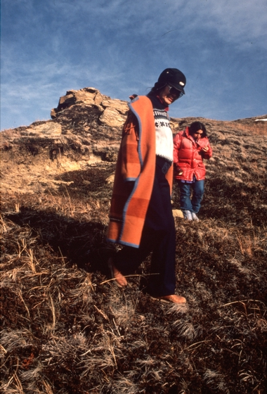 'Mary Louise is shown here with Winona Flying Earth atop Double Woman Hill (Winyannumpa) west of Shields, North Dakota. Mary Louise received a North Dakota Council on the Arts Traditional Arts Apprenticeship Program grant in 1986 to teach Winona traditional stories, such as the one related to this hill. Double Woman is a mythical being that is said to appear to people in dreams and who is associated with artistry, design and industriousness.'  December 16, 1986, comments and photograph by Troyd Geist, courtesy North Dakota Council on the Arts