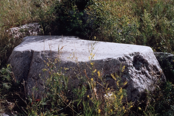 'This is a 'writing rock' in southeastern North Dakota. The marks, figures and cupules are said to be petroglyphs with special meaning. Mary Louise Defender-Wilson is one of very few people who know the stories associated with this particular rock. In fact, she is recognized as a cultural authority with regard to the place names and environmentally-related stories tied to special buttes, unusual rocks, streams, and other geographic features found throughout the Midwest.' July 30, 1998, comments and photograph by Troyd Geist, courtesy North Dakota Council on the Arts