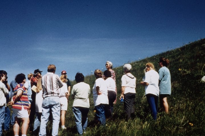 'Mary Louise Defender-Wilson is giving a storytelling presentation to a group of K-12 teachers.  She is telling the story about Lesser Bear's Lodge (a pyramid-shaped hill in southeastern North Dakota) and about its opposite hill, Greater Bear Lodge, which is on the Spirit Lake Indian Reservation.' June 14, 1998, comments and photograph by Troyd Geist, courtesy North Dakota Council on the Arts