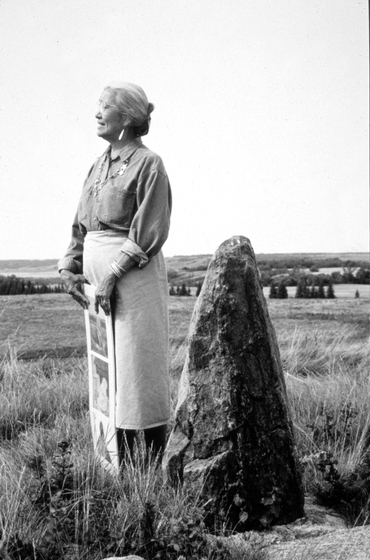 Mary Louise Defender-Wilson is a living cultural repository of many rare, traditional stories. She shown here atop a hill near a rock considered special by the Dakotah, Sisseton, and Whapeton Sioux. August 1993, comments and photograph by Troyd Geist, courtesy North Dakota Council on the Arts