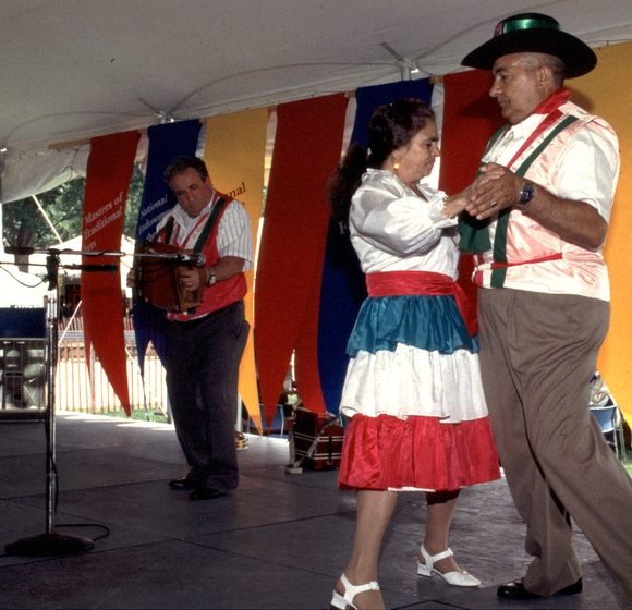 The DeFranco family with Franco Cofone, 1994 Festival of American Folklife, courtesy Ralph Rinzler Folklife Archives and Collections, Center for Folklife and Cultural Heritage, Smithsonian Institution