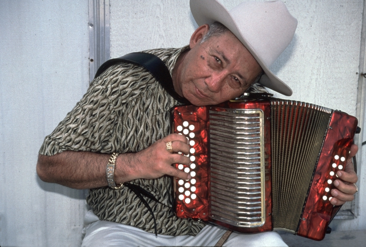 "Accordionist Antonio ""Tony"" De La Rosa helped to reshape the modern Mexican American *conjunto* sound with his staccato fingering style, by adding drums and replacing the upright bass with the amplified instrument. Photograph by Alan Govenar"