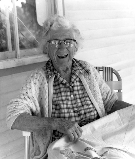 "Quilter and needleworker Amber Densmore laughed at having so little in her possession to show for a lifetime of work. ""I've given it all away!"" she said. ""You'll just have to go see my grandchildren."" 1988, photograph by Jane C. Beck, courtesy National Endowment for the Arts"