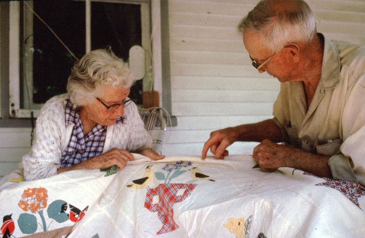 Amber and Sabin Densmore with Amber's quilt, 'Birds and Flowers', Chelsea, Vermont, August 1988, photograph by Jane C. Beck, courtesy Vermont Folklife Center