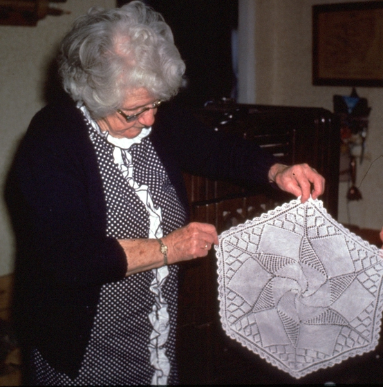 Amber Densmore holding one of her doilies, Chelsea, Vermont, January 1990, photograph by Jane C. Beck, courtesy Vermont Folklife Center