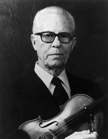Lyman Enloe started in music playing rhythm guitar in a family ensemble but switched to fiddle in his early 20s. He was a renowned square dance fiddler, and in later years also played in bluegrass groups. Photograph by Ted Houb, courtesy National Endowment for the Arts
