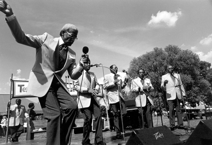Fairfield Four (left to right) Samuel McCrary (rear under banner) Reverend Willie Richardson, Robert Hamlett, Wilson Waters, James Hill, Isaac Freeman, Tennessee Grassroots Day, Nashville, September 26, 1987, photograph by Robert Cogswell, courtesy Tennessee Arts Commission