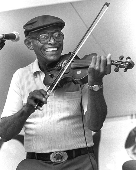 "African American Creole fiddler Canray Fontenot played for more than forty years with accordionist Alphonse ""Bois Sec"" Ardoin. Fontenot mastered the traditional repertoire and created a style he called the ""blues waltz."" Chicago Blues Festival, 1989, photograph by Jack Vartoogian"