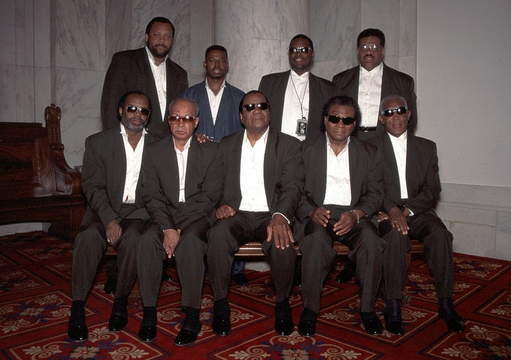"Clarence Fountain (seated, center), leader of the Blind Boys, said of the gospel group's long, successful career, ""We started to run (tour) in 1944, we started runnin' and singing for the Lord, and it wasn't nothing but the hand of the Lord that brought us through all these years and made us what we are."" 1994, National Heritage Fellowship Ceremonies, Courtesy National Endowment for the Arts"