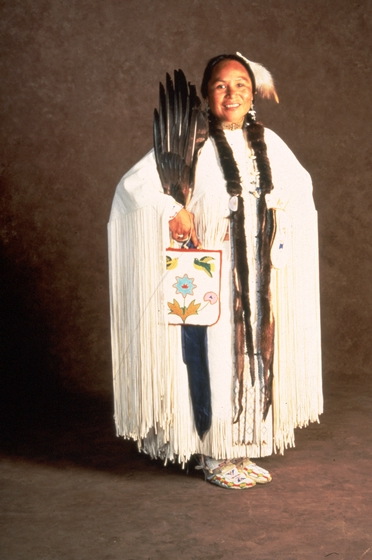 Sophia George with one of her beaded bags and a feather fan, courtesy Oregon Folklife Program