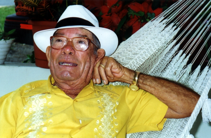 "José González reclines in one of his hammocks in his hometown, San Sebastian, Puerto Rico. He began weaving hammocks, known in Puerto Rico as ""the poor man's bed"" when he was 7. Courtesy National Endowment for the Arts"