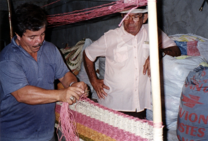 José González (right) working on one of his hammocks with an assistant, San Sebastian, Puerto Rico, courtesy National Endowment for the Arts