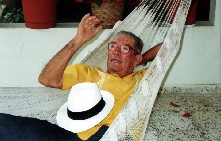 José González reclining in one of his hammocks, San Sebastian, Puerto Rico, courtesy National Endowment for the Arts