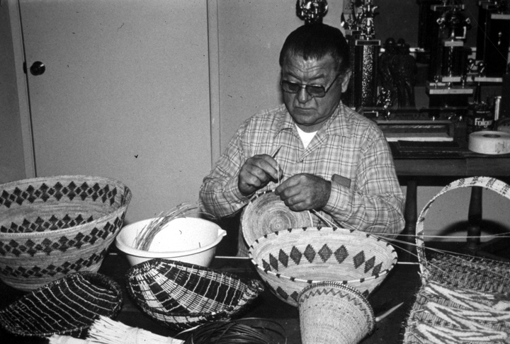 "Native American basket maker Ulysses ""Uly"" Goode, a member of the Western Mono tribe, said he was drawn to the craft because it was a means to ""make an extraordinary object out of ordinary materials."" Photograph by Brian Bibby, courtesy National Endowment for the Arts"