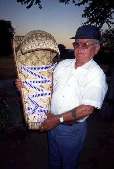 Ulysses 'Uly' Goode holding one of his cradle baskets, photograph by Ron Goode, courtesy National Endowment for the Arts