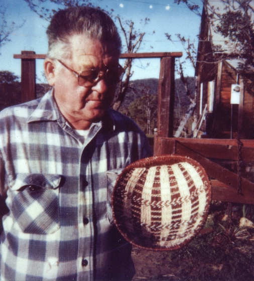 Ulysses 'Uly' Goode holding one of his Western Mono seed baskets, photograph by Ron Goode, courtesy National Endowment for the Arts