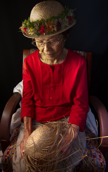 Gladys Kukana Grace making a hat, Bethesda, Maryland, 2010, photograph by Alan Govenar