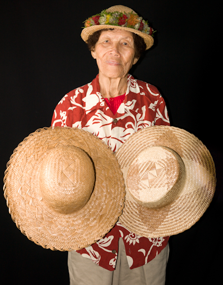 Gladys Kukana Grace with two of her hats, Bethesda, Maryland, 2010, photograph by Alan Govenar