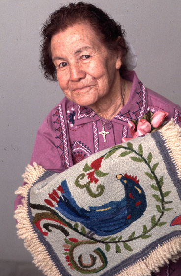 "Hispanic American embroiderer Frances Varos Graves began making *colchas* (blankets) in Carson, New Mexico, in the 1930s. As other women followed her example, a ""Carson *Colcha*"" style emerged. 1994 National Heritage Fellowship Ceremonies, photograph by William K. Geiger, courtesy National Endowment for the Arts"