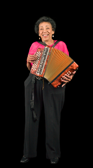 "Louisiana native Ida Guillory began playing the accordion again after moving to Northern California. A reporter dubbed her ""Queen Ida"" when she was named Queen of the Mardi Gras at a church celebration. Bethesda, Maryland, 2009, photograph by Alan Govenar"