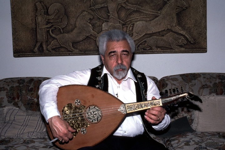 Richard Hagopian, the son of Armenian immigrants, was 13 when he began learning the *oud*, a short-necked lute that is the principal instrument of the Arab world. Here, he is pictured performing in the living room of his home in Visalia, California. 1991, photograph by Alan Govenar