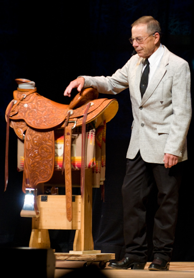Dale Harwood with one of his saddles, 2008 National Heritage Fellowship Concert, Bethesda, Maryland, photograph by Alan Hatchett