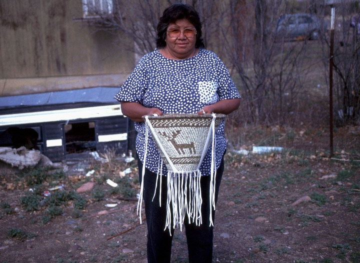 Evalena Henry holding a traditional burden basket, courtesy National Endowment for the Arts