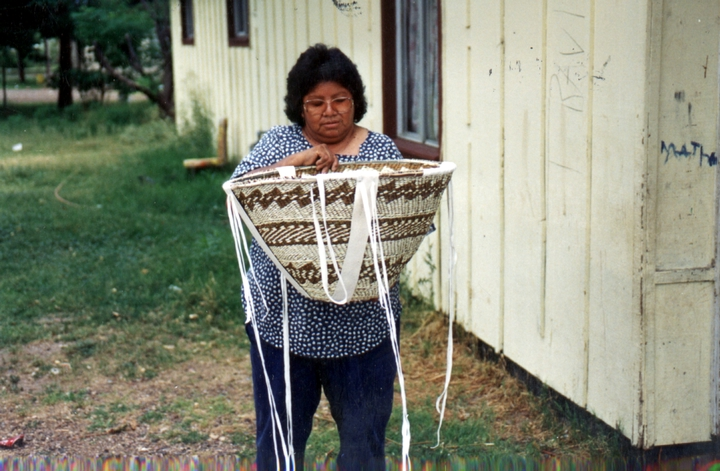 Evalena Henry holding a ceremonial burden basket, Courtesy National Endowment for the Arts
