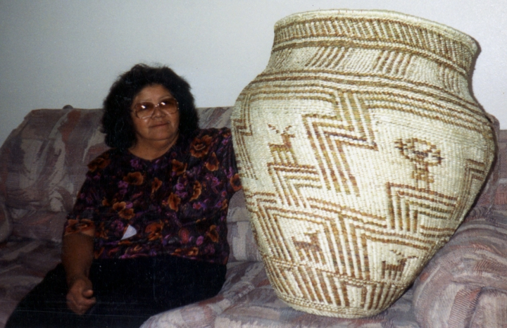 Evalena Henry with a giant *tus* basket, courtesy National Endowment for the Arts