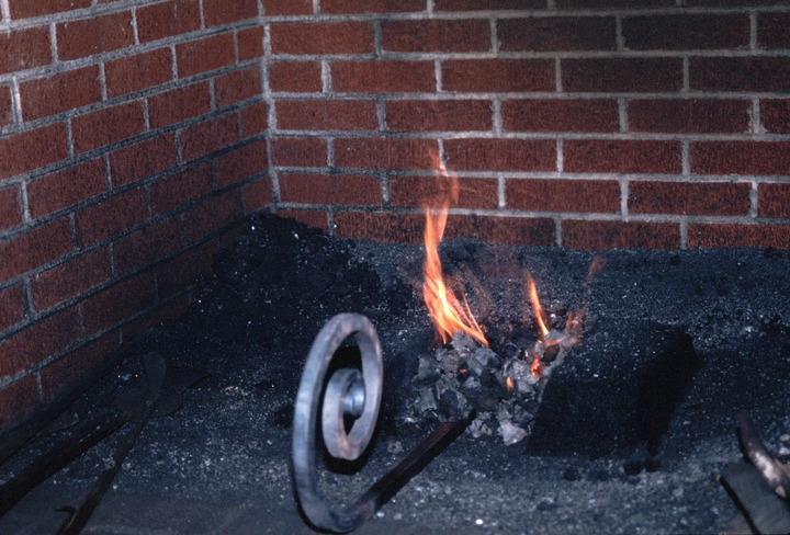 Heating ironwork at Hensley & Son Forge, Spruce Pine, North Carolina, 1997, photograph by Alan Govenar