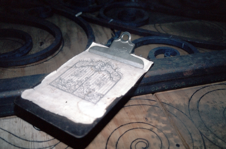 Clipboard and drawings for ornamental ironwork, Hensley & Son Forge,Spruce Pine, North Carolina, 1997, photograph by Alan Govenar