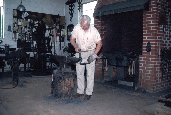 Bea Ellis Hensley at work, Hensley & Son Forge, Spruce Pine, North Carolina, 1997, photograph by Alan Govenar