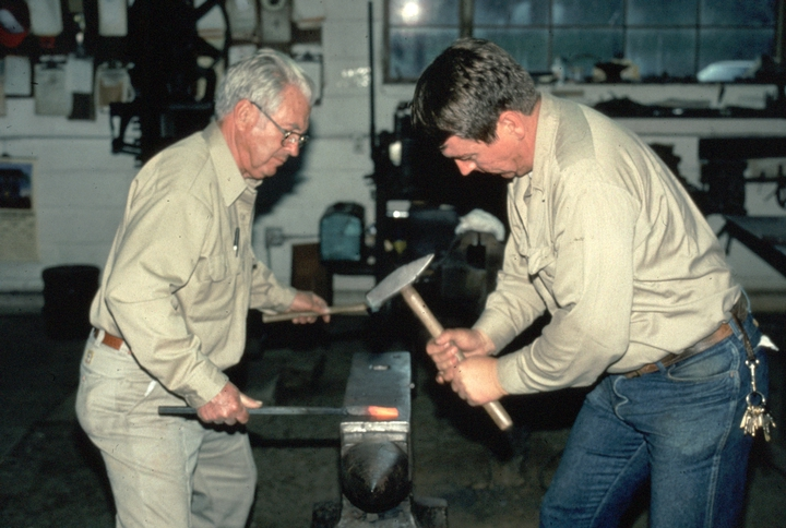 Bea Ellis Hensley and his son, Mike, at work, Hensley & Son Forge, Spruce Pine, North Carolina, 1997, photograph by Alan Govenar