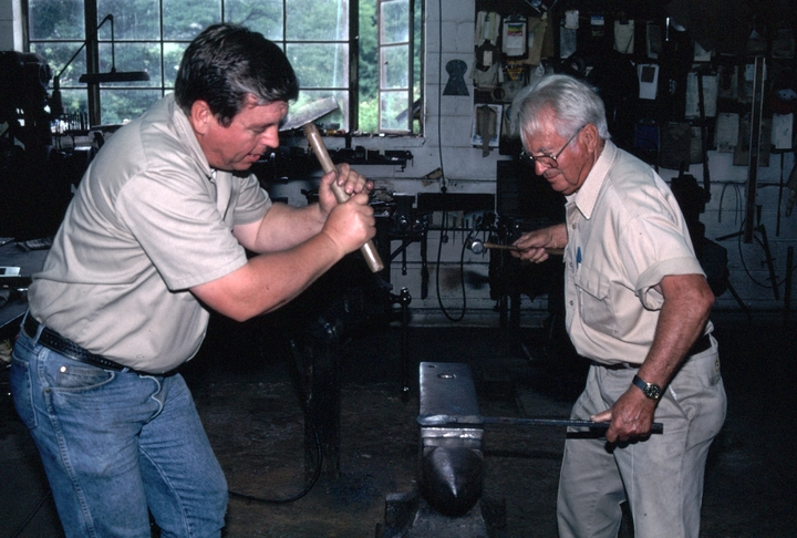Bea Ellis Hensley and his son, Mike, at work, Hensley & Son Forge, Spruce Pine, North Carolina, 1997, photograph by Alan Govena