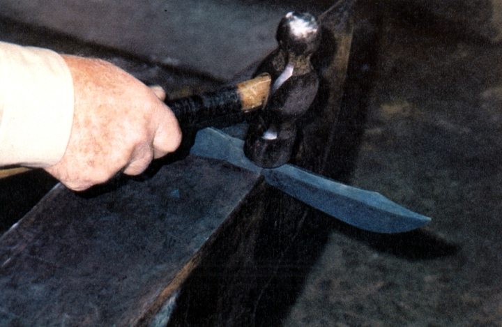Bea Ellis Hensley hammering a knife, Hensley & Son Forge, Spruce Pine, North Carolina, courtesy Bea Ellis Hensley