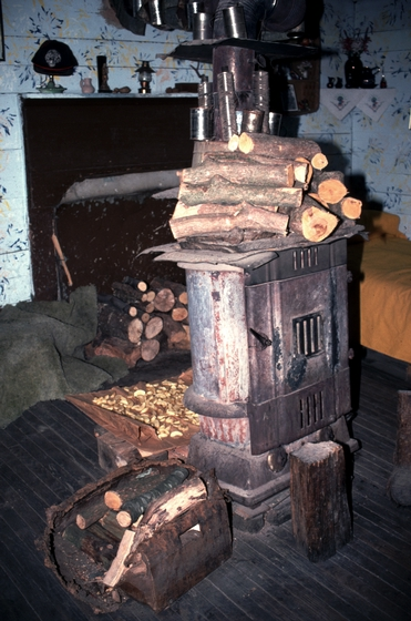 Wood stove in Ray Hicks' cabin, Banner Elk, North Carolina, 1991, photograph by Alan Govenar