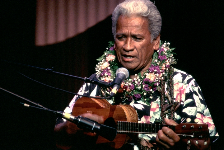 Native Hawaiian musician Solomon Ho'opi'i grew up performing with his brother, Richard. Their music is distinguished by an energetic style of falsetto singing that includes features carried over from ancient native chants. 1996 National Heritage Fellowship concert, courtesy National Endowment for the Arts