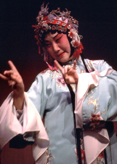 "Hua Wenyi, born in Shanhai, is a singer in the *kunqu* style of Chinese opera, considered the oldest and most refined. After immigrating to the United States in 1989, she established the nonprofit Hua Kun Opera. Here, she performs the role of Tu Li-Niang in ""The Peony Pavilion,"" courtesy National Endowment for the Arts"