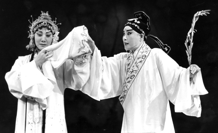 The Lan Ting Chinese Opera Troupe performs 'The Peony Pavilion' at the Taipei Theater. Here, Hua Wenyi (left) enacts the role of Tu Li-Niang with Kao Hui-lan as Lui Meng-mei, a young scholar. New York, New York, June 8, 1994, photograph by Jack Vartoogian