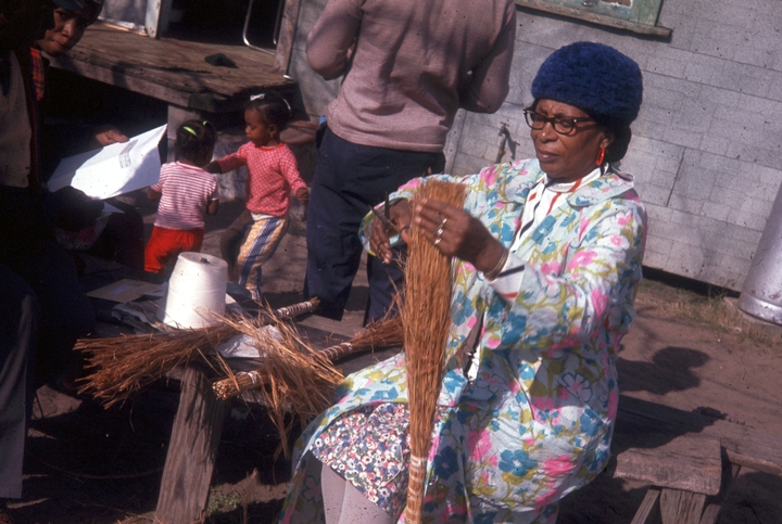 Janie Hunter grew up on Johns Island, one of the Georgia Sea islands off the coast of South Carolina. She was multitalented — storyteller, quilter, singer and artisan. Here, she is pictured making a broom in 1972. Courtesy National Endowment for the Arts