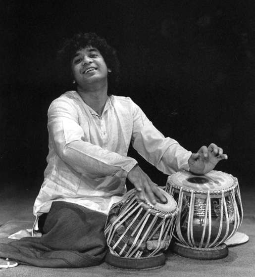 Zakir Hussain playing Indian *tabla* drums, 1989, photograph by Jack Vartoogian
