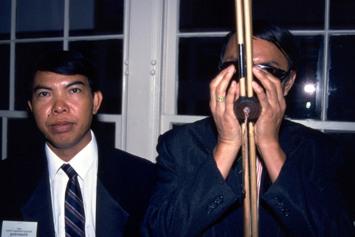 Khamvong Insixiengmai (left), Washington, D.C., 1991, photograph by Alan Govenar