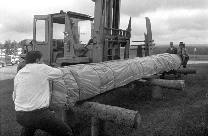 Nathan Jackson (right) at work on a carved pole, 1988, courtesy Alaska State Council on the Arts