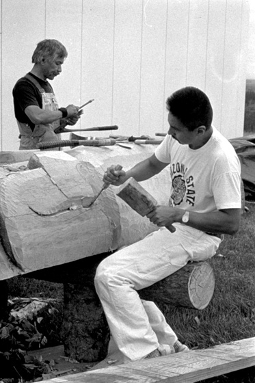 Nathan Jackson (left) at work on a carved pole,1988, courtesy Alaska State Council on the Arts