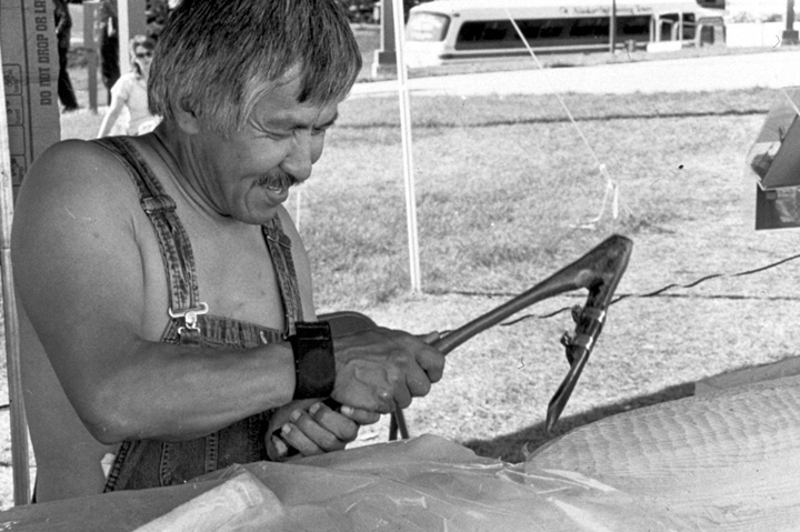 Nathan Jackson at work on a carved pole, 1988, courtesy Alaska State Council on the Arts