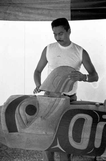 Nathan Jackson's assistant at work on a carved pole, 1988, courtesy Alaska State Council on the Arts