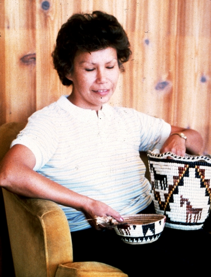 Nettie Kuneki Jackson holding two of her Klickitat cedar root baskets, courtesy National Endowment for the Arts