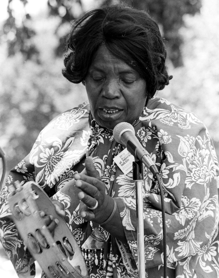 "Georgia sea island singer Bessie Jones said she was ""called to teach"" — to pass on what she knew about slavery through the songs and stories she had learned as a child. 1974 Festival of American Folklife, courtesy Ralph Rinzler Folklife Archives and Collections, Center for Folklife and Cultural Heritage, Smithsonian Institution"