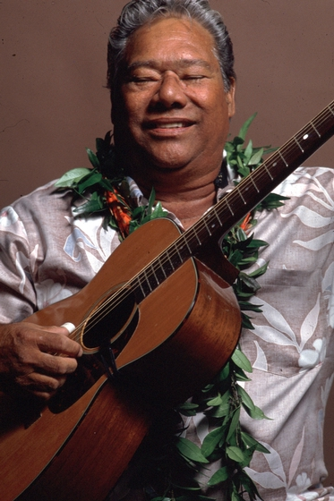 Raymond Kane, a Native Hawaiian musician and singer, began learning to play slack key guitar from cowboys when he was 9. The distinctive guitar style makes use of open tunings. 1987 National Heritage Fellowship Ceremonies, courtesy National Endowment for the Arts.