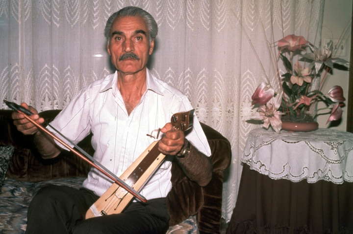 Ilias Kementzides, a Pontic Greek, began playing the *lyra*, a three-stringed violin, when he was 8. After he immigrated to the United States, he became a popular performer at weddings, christenings, baptisms and other community events. Here, he plays the instrument in his living room in Norwalk, Connecticut. 1991, photograph by Alan Govenar